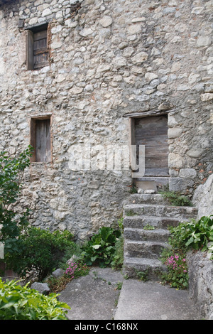 Old stone cottage in the historic town of Entrevaux, France - Stock Photo
