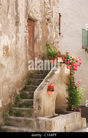 Stone steps to a medieval house in Entrevaux, France - Stock Photo