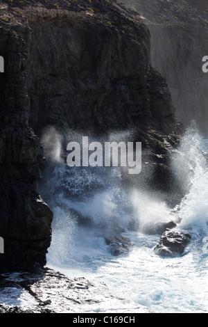 Heavy Atlantic seas breaking against rocks at the seaside village of Los Molinos on the Canary Island of Fuerteventura - Stock Photo