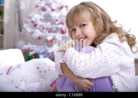 xmas girl in bed - Stock Photo
