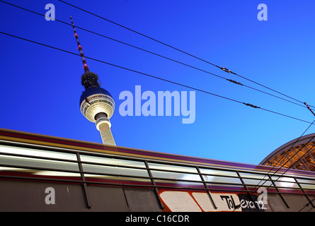 S-Bahn, metro train in front of the television tower, Alexanderplatz, Berlin, Germany, Europe - Stock Photo