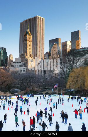 People skate on ice with white Christmas in Central Park welcome the new year of 2010. Manhattan, New York City. - Stock Photo