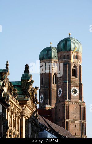 Palace in Kardinal-Faulhaber Street 10 and Frauenkirche Cathedral, Munich, Bavaria, Germany, Europe - Stock Photo