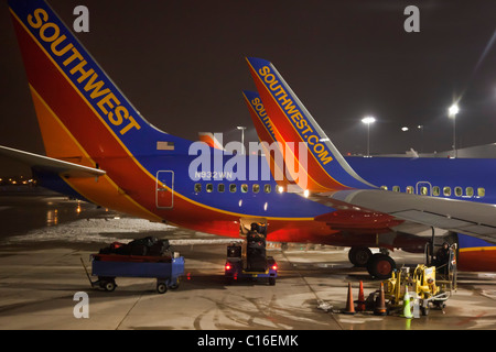 Detroit, Michigan - Southwest Airlines planes at night at Detroit Metro Airport. - Stock Photo