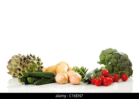 Mixed vegetables, artichokes, broccoli, potatoes, zucchini, onions, beans, cucumber and tomatoes - Stock Photo