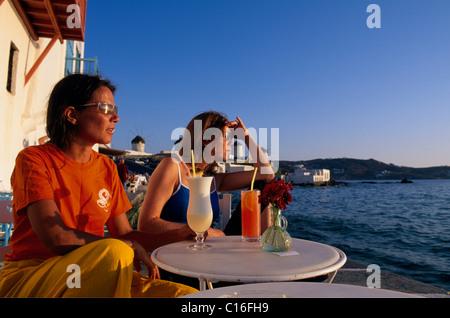 Sundowners in Little Venice, Mykonos town, Mykonos Island, Cyclades, Greece, Europe - Stock Photo