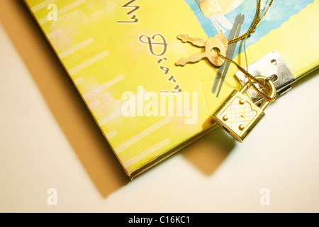 Diary with lock and key - Stock Photo