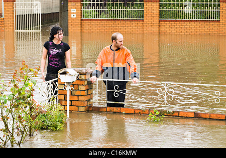 Flash flooding in the city of Ballarat Victoria Australia.Residents watch the rising flood water with concern. - Stock Photo