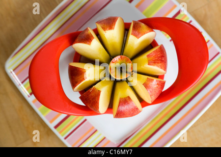 An apple cut into pieces - Stock Photo