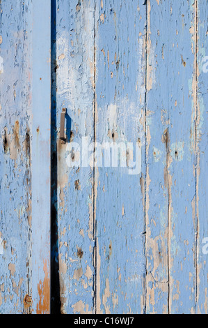 Old blue wooden doors with flaking paint, boat garage, Milos, Cyclades, Greece, Europe - Stock Photo