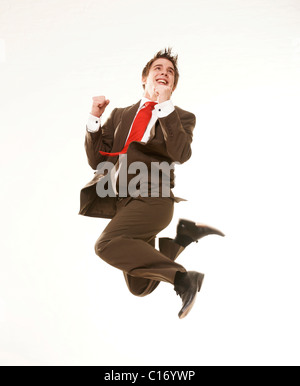 Young businessman, jumping in the air - Stock Photo