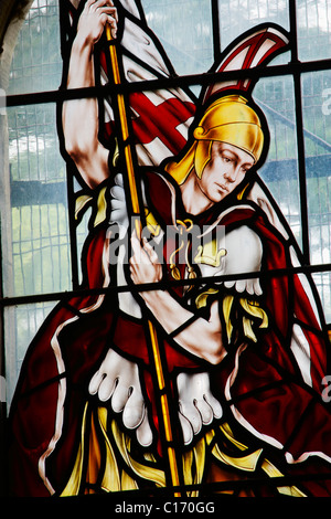 Stained glass window depicting Saint George - Stock Photo