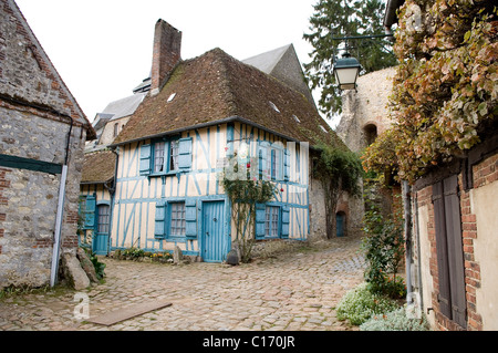 Half-timber house on cobbled street in picturesque French village of Gerberoy - Stock Photo