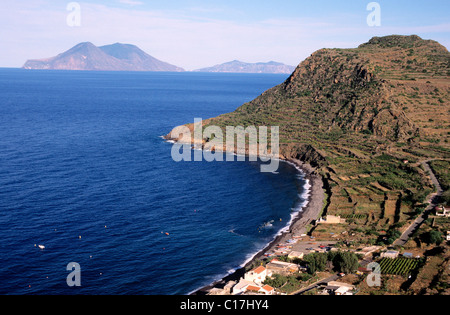 Italy, Sicily, the Eolian Islands, Filicudi, the small harbour & the bay & Capo Graziano above, in the back Lipari - Stock Photo