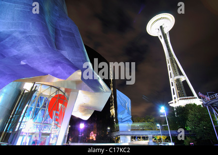 Space Needle next to the building of the Experience Music Project, EMP, and the Science Fiction Museum, SFM, Seattle - Stock Photo