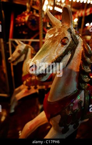 Horses on a children's merry-go-round by night at Wiener Prater, Vienna, Austria, Europe - Stock Photo