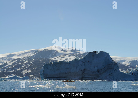 Icebergs and kayakers in the Stoklund-Fjord, East Greenland, Greenland - Stock Photo