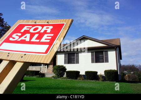 House with For Sale Sign Focus on For Sale Sign - Stock Photo