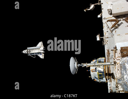 Space Shuttle Discovery and the International Space Station - Stock Photo