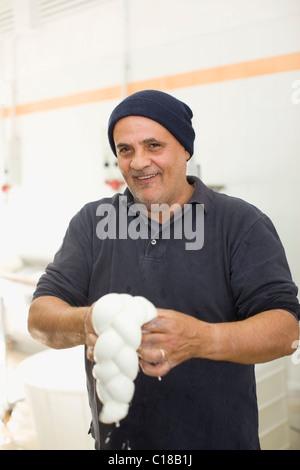 Bison mozzarella manual production - Stock Photo