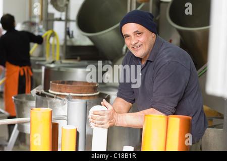 Artisan bison mozzarella production - Stock Photo