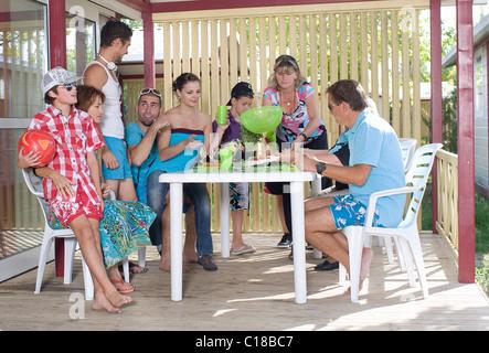 Family vacation picnic on terrace - Stock Photo