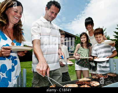 Family queueing for barbeque - Stock Photo