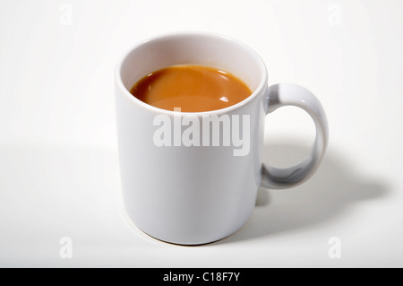Mug of tea - strong cup of tea in a plain white mug - Stock Photo