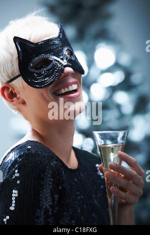 Woman wearing a cat mask - Stock Photo