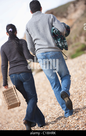 Couple going for a picnic - Stock Photo