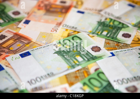 Various banknotes in Euro currency - Stock Photo