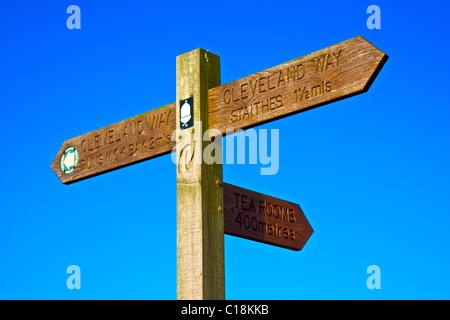 Wooden sign post set against a blue sky, located along the Cleveland Way, North Yorkshire, England UK - Stock Photo