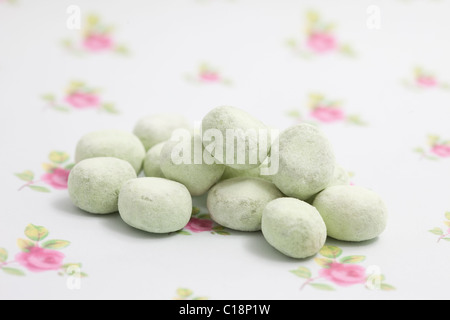 apple bonbons sweets and candy on a paper background photographed in a studio - Stock Photo
