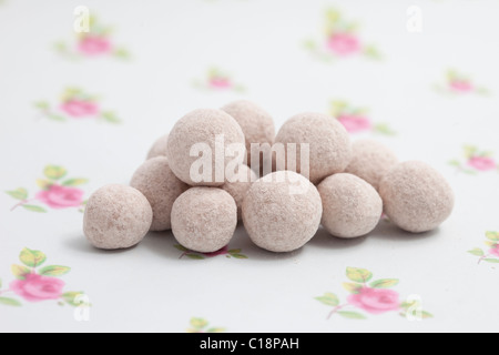 chocolate bonbons sweets and candy on a paper background photographed in a studio - Stock Photo