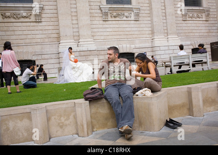 An Asian bride is photographed in the grounds of Saint Paul's Cathedral. - Stock Photo