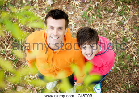 Man and woman ready for workout in park - Stock Photo