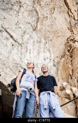 Man and woman on mountain excursion - Stock Photo
