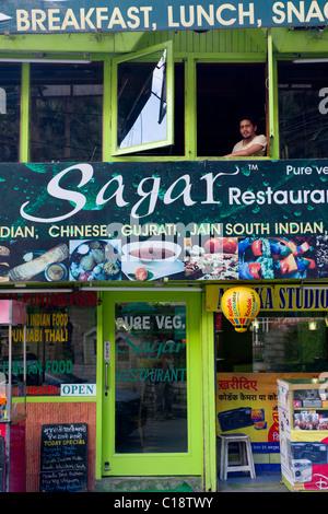 Man in the upstairs window of the Sagar Restaurant, Manali, Himachal Pradesh, India
