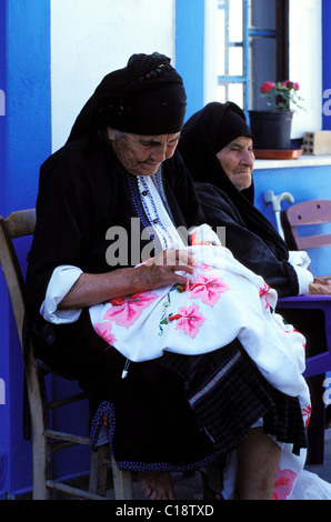 Greece, the Dodecanese, Karpathos Island, women with traditionnal wear in the village of Diafani - Stock Photo
