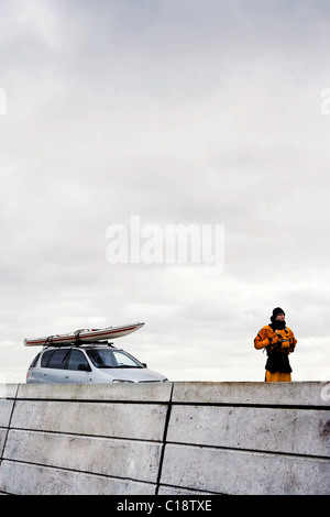 Man in front of car with kayak - Stock Photo
