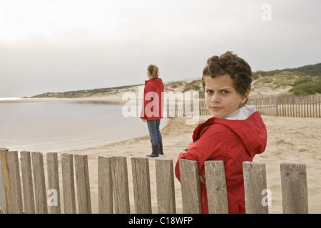 Young boy looking at camera seriously - Stock Photo