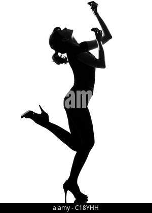 full length silhouette in shadow of a young woman ancing flamenco  in studio on white background isolated - Stock Photo