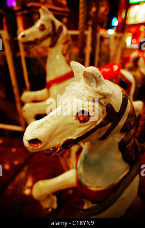 Horses on the children's roundabout at night in Vienna Prater Park, Vienna, Austria, Europe - Stock Photo