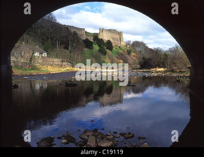Landscape of Richmond Castle & reflections in still water framed by arch of bridge over the River Swale Richmond - Stock Photo