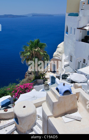 View over a sun terrace and the town of Thira, Fira, with typical Cycladic architecture, Santorini, Cyclades, Greece, - Stock Photo