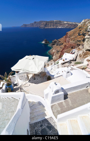 View over a sun terrace and the town of Thira, Fira, on a crater's edge with typical Cycladic architecture, Santorini, - Stock Photo
