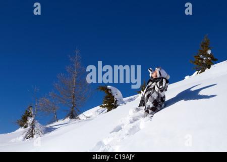 Woman taking sun bath at mountain outdoors - Stock Photo