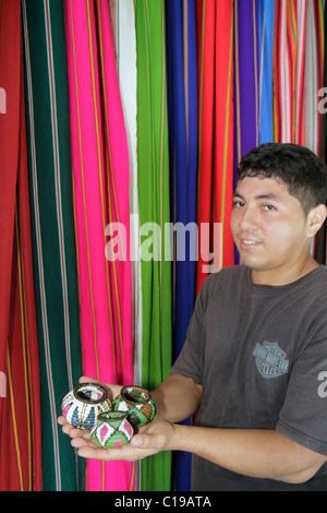 Panama City Panama Balboa Centro de Artesenias shopping handicrafts textiles souvenirs display small woven basket - Stock Photo