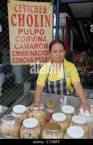 Panama City Panama Ancon Mercado de Mariscos market selling seafood vendor merchant Hispanic woman jars ceviche - Stock Photo