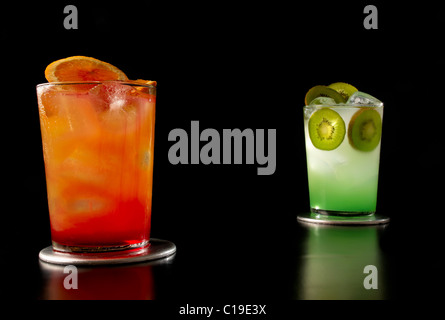 Two designer cocktails isolated on black background - Stock Photo
